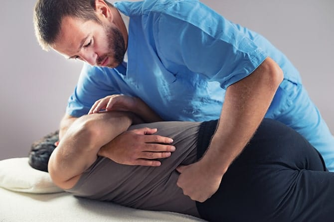 Chiropractor doing a back adjustment