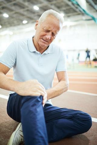 elderly man having knee pain