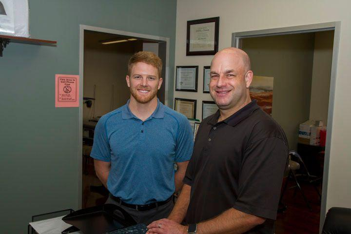 Chiropractors in Sugar Land TX Dr. Jeff Hogan and Dr. Benson Side by side