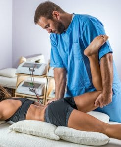 chiropractor adjusting female patients right hip
