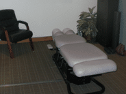 Hogan Spine and Rehab traction table for examining patients.