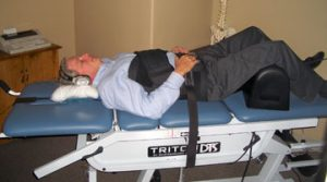 Spinal Decompression table with man visiting his chiropractor after a car crash