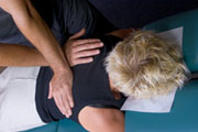 Chiropractor in sugar land texas performs and adjustment on a female patient.