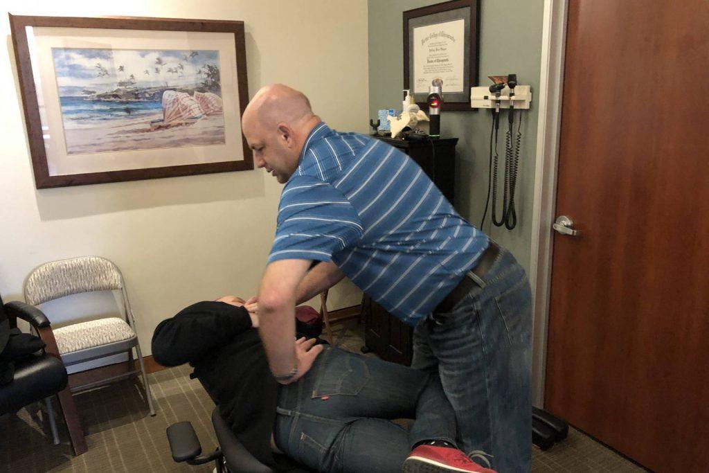 Doctor Hogan at Hogan Spine & Rehab adjusting a patient's back.