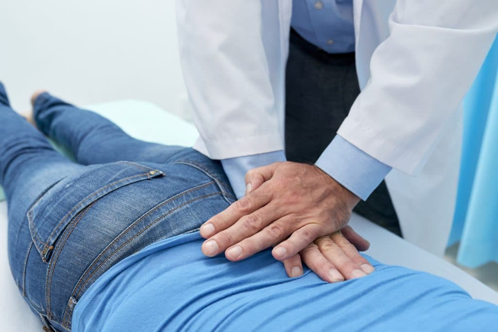 sugar land chiropractor adjusting patient's back