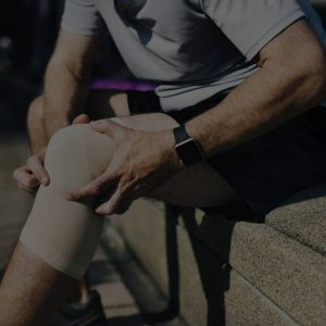 Man holding his knee due to pain