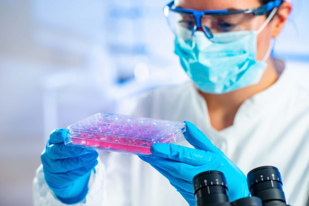 Stem cell researcher holding a sample