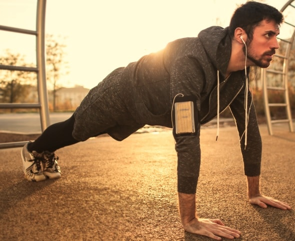 a man doing a pushup Strength Exercises
